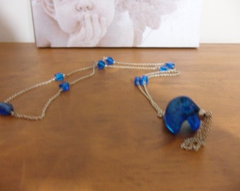 Blue Indian glass beaded necklace on silver metal chain, with statement twisted glass pendant.