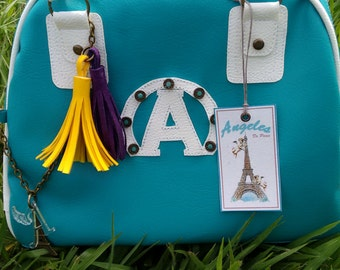 Handbag turquoise fringed colors.
