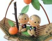 Vintage kokeshi doll Ref A, Mandarin orange, Bamboo basket