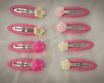 Girls pink hair clips with flowers