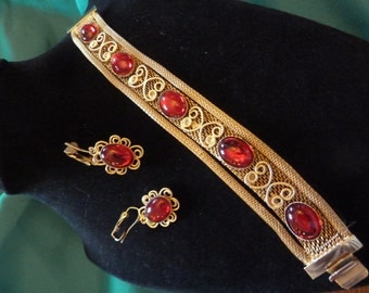 Vintage Gold Tone Mesh Bracelet with Deep Red Cabochons and Matching Earrings