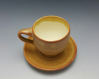 Handmade ceramic espresso cup and saucer by Potteryi. Small tea cup and saucer set on oatmeal and cream. Perfect size for cappuccino.