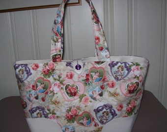 Shopper/Tote in a heart print cotton with Faux leather.Great for the business women,Has lots of room on the inside. 17 in wide,11 in long.