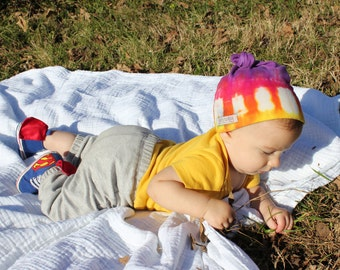 Purple rainbow knot top baby hat,  organic cotton, one size fits all