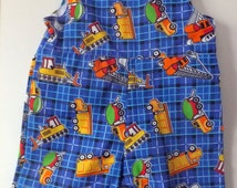 Baby rompers. Blue with truck motif. Summer clothes.
