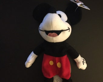 Mickey Mouse Pie Eye Minnie.  Retired with tags