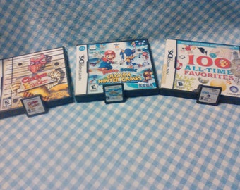 Lot of 3 Nintendo DS Game Cartridges w/manual in cases (Mario*Sonic Olym Winter Games / Chicken Blaster / 100 All Time Favorites)