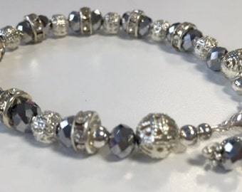 Reduced - Stunning crystal and silver filigree bracelet and earring set