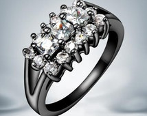 Ladies black gold ring with crystals gold GP