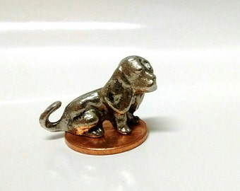 Collectible miniature puppy figurine.