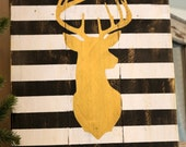 gold deer sign black and white wood sign