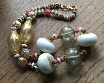 Necklace of vintage Venetian hand made beads, blown glass and lamp work.