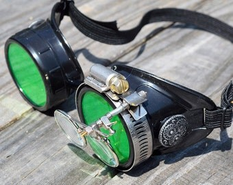 STEAMPUNK GOGGLES, Black with Green Lenses, Silver Accents and Magnifying Loupes, Great for Halloween, Cosplay Costume or Birthday Gift
