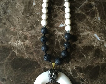 Beaded necklace with horn with swarovksi crytals