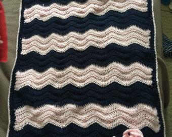 Crocheted baby bassinet blanket