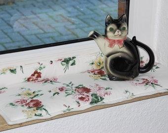 Cuddly cat cushions, window cushions