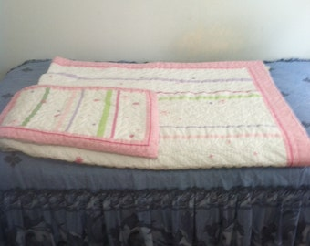 Baby quilt homemade with matching pillow case
