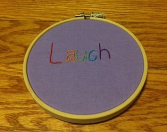 Laugh embroidery hoop art