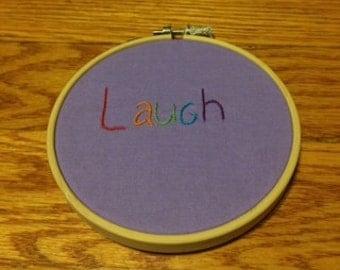 Laugh embroidery hoop art