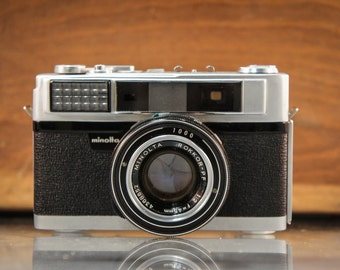 Minolta AL Camera W/ Rokkor-PF 45mm F2 Lens - For Display