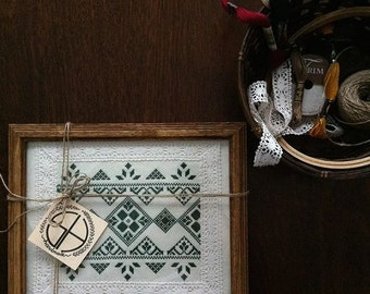 Framed cross stitch traditional pattern