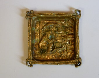 Vintage brass ashtray with unusual man with umbrella boat design