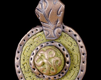 Polymer clay celtic sheild pendant on black leather thong necklace