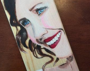 Vera Farmiga painting on a wooden box