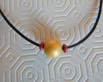 gold and magenta wood bead shocker neckalce - 14'' long