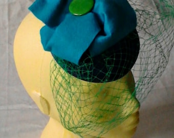 Fascinator: Sea Breeze felt and birdcage veil Fascinator