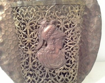 Filigree wall decor, soldier? design