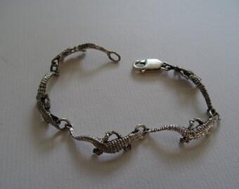 Crocodile bracelet.
