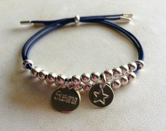 Custom bracelet made in silver 925. Blue elastic.