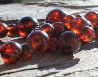 49 Root Beer Lucite Round Beads  One Strand Sizes Vary