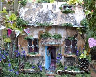 Fairy cottage / miniture house . Made for all the fairy's or angels to visit.