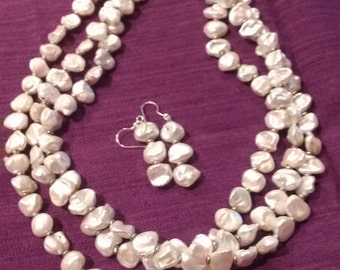 White Freshwater Pearls.  3 strands