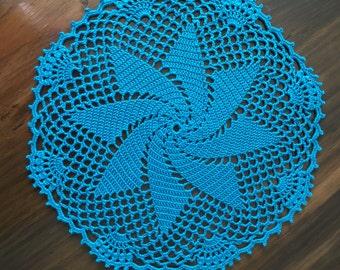 Blue pinwheel doily