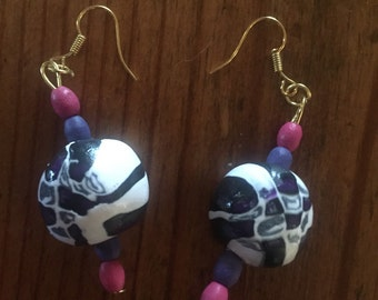 Large bead earrings in purple and pink swirls with purple and pink wood beads