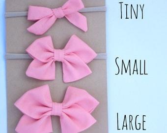 Peach fabric bow