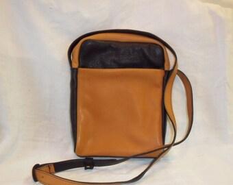 man, Brown and black leather wallet, worn adjustable shoulder strap