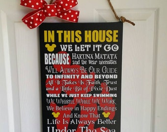 In this house Disney themed 22x12 wood sign