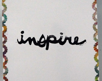 "Un-mounted, hand carved rubber stamp, ""Inspire"""
