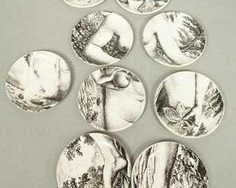 A group of (8) Fornasetti coasters