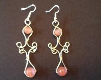 Pink cat eye earrings