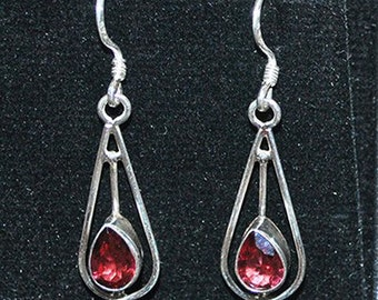 Silver earrings with garnet settings