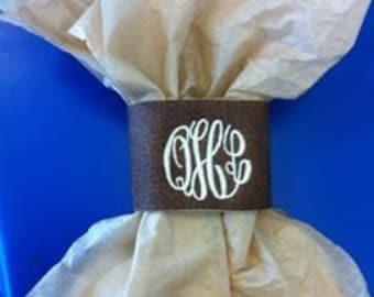 Monogrammed leather cuff bracelet.