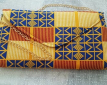 Dashiki clutch and high target shoulder bags made from kente print. Medium size