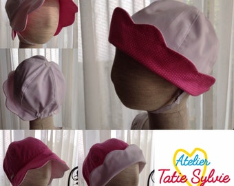 Retro hat with reversible pink/white polka dots
