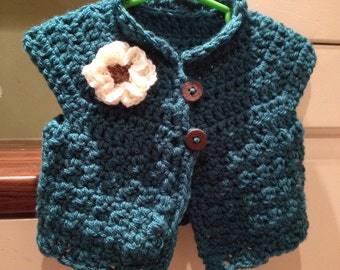 Crochet Gilet in tourquoise 6-9 months.