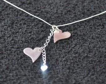 Handmade Fine silver 2 hearts charm necklace.